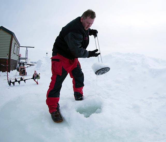 Before the competition starts, volunteers drill 20,000 eight-inch holes through the ice, which is two feet thick.
