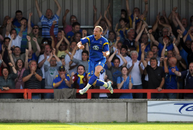 Wimbledon's Gareth Gwillim celebrates scoring against Port Vale at the Cherry Red Records Fans' Stadium.
