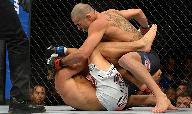 Renan Barao make quick work of Uriah Faber in their bantamweight championship fight on Feb. 1.
