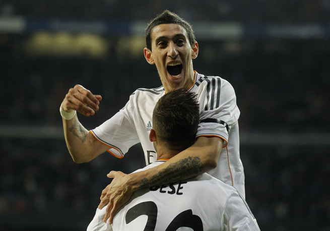 Real Madrid's Angel Di Maria, top, and Jese Rodriguez celebrate after connecting for a goal in the club's 3-0 rout of rival Atletico Madrid in the first leg of the Copa del Rey semifinals