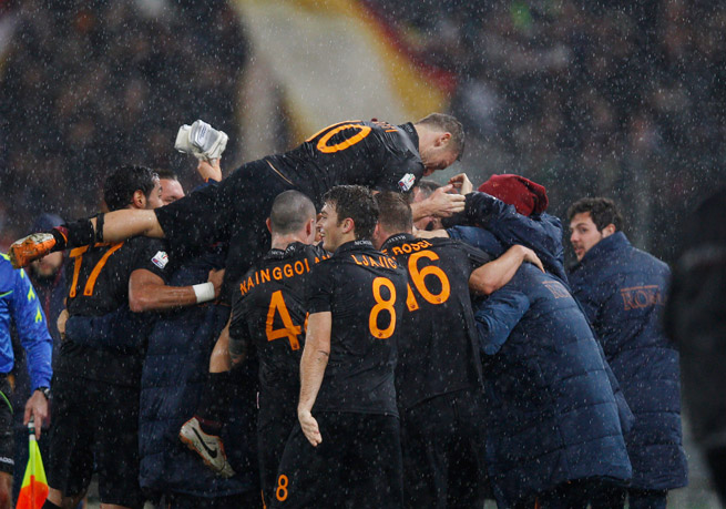 Francesco Totti leaps into the team celebration after a Roma goal in Wednesday's 3-2 victory over Napoli in the first leg of the Coppa Italia semifinals.