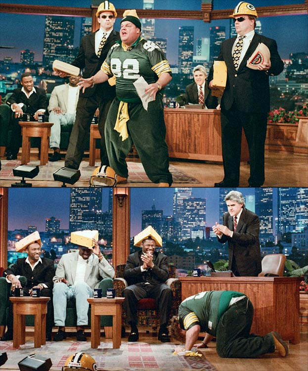 Chris Farley appeared as Mayor Cheddar McFarley of Stitzer, Wisc., to pay tribute to Green Bay Packers players Andre Rison, Edgar Bennett, and Sean Jones, just two days after they won the Super Bowl. The mayor crowned the players with cheese heads.