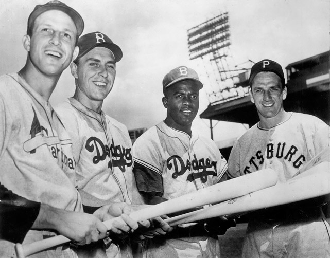 St. Louis Cardinals OF Stan Musial, Brooklyn Dodgers 1B Gil Hodges, Brooklyn Dodgers 2B Jackie Robinson and Pirates OF Ralph Kiner pose before the start of the All-Star Game at Briggs Stadium in Detroit on July 10, 1951. The National League won 8-3.