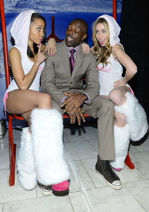 His NFL days may be behind him, but the mercurial TO is still attracting the ladies. Here he is with a pair of sporty models at Maxim's BIG GAME Weekend -- BIG GAME not to be confused with the heavily trademarked Superb Owl.