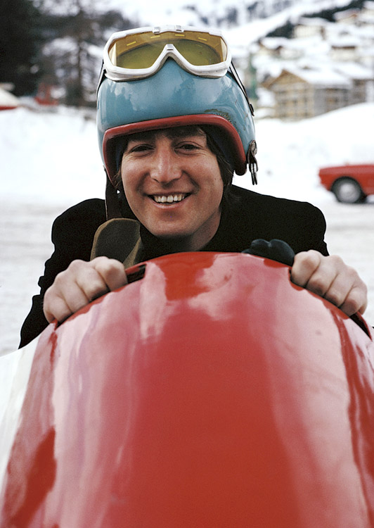 John Lennon goes tobogganing in St. Moritz, Switzerland.