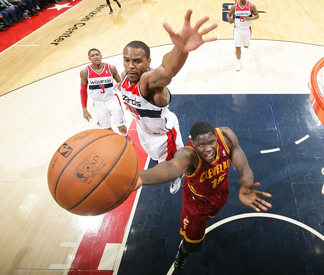Cleveland Cavaliers forward Anthony Bennett attempts to lay the ball in as Trevor Booker of the Washington Wizards defends. The Cavs won 115-113.