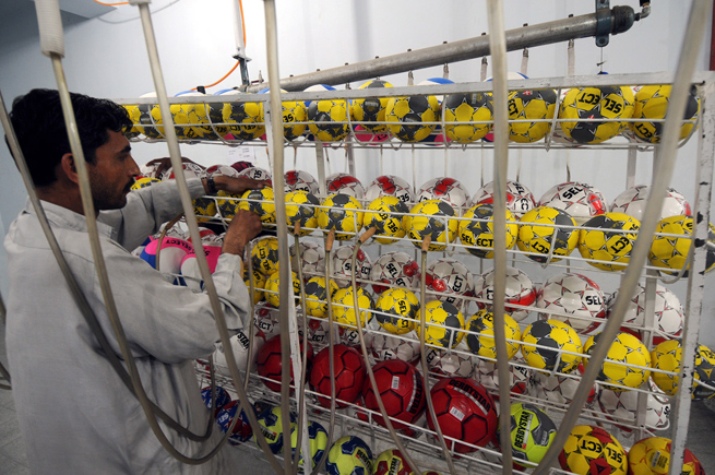 A worker inflates soccer balls at a factory in Sialkot, Pakistan.