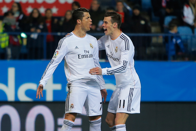 Real Madrid star Cristiano Ronaldo, left, celebrates one of his two penalty kick goals against Atletico Madrid with Gareth Bale.
