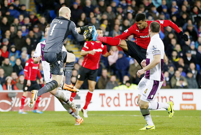 U.S. and Aston Villa goalkeeper Brad Guzan snares the ball off Cardiff City striker Frazier Campbell's foot during their 0-0 Premier League draw on Tuesday.