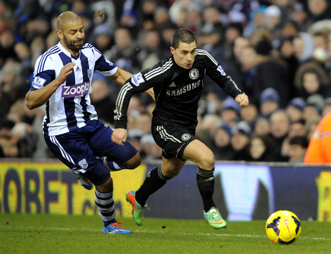 Chelsea's Eden Hazard, right, turns the corner on West Brom's Steven Reid during their teams' 1-1 Premier League draw on Tuesday.