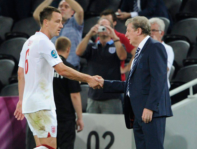 English defender John Terry, left, has retired from international play, and England manager Roy Hodgson, right, says he has no intentions of trying to call him back in.