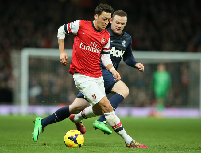 Arsenal's Mesut Ozil, left, and Manchester United's Wayne Rooney go at one another during Wednesday's scoreless draw in London, though neither attacking star could provide a breakthrough.
