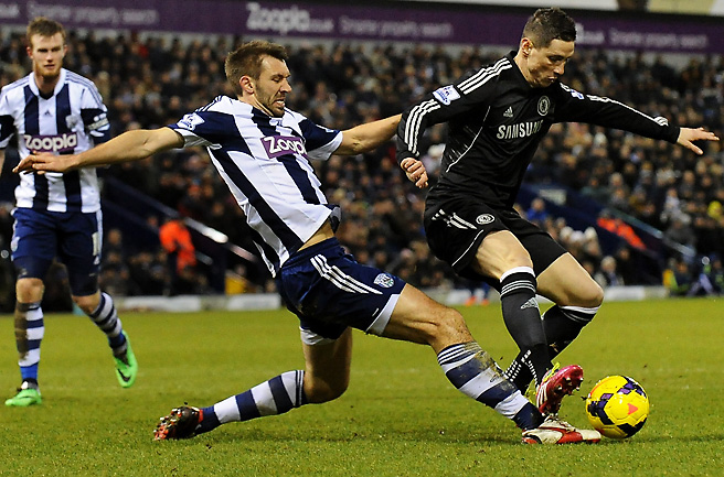 West Brom's Gareth McCauley slides toward Chelsea's Fernando Torres during the squads' 1-1 draw.