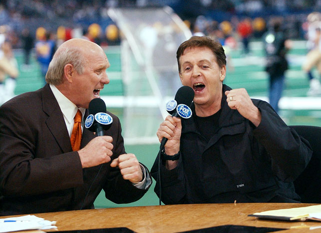 "Terry Bradshaw and Sir Paul McCartney sing a duet of ""A Hard Day's Night"" during Super Bowl XXXVI at the Superdome in New Orleans."