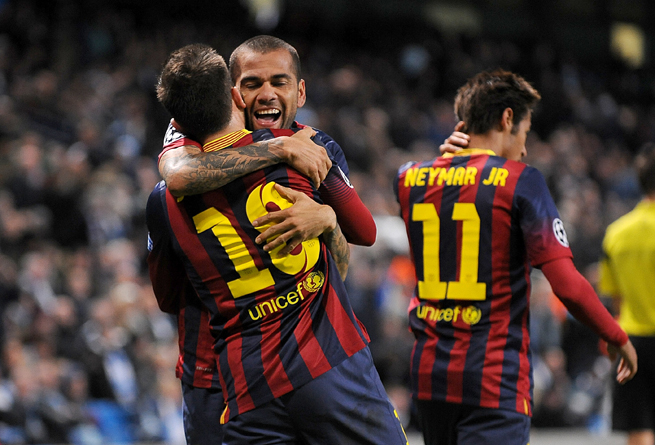 Goal scorers Lionel Messi (10) and Dani Alves share a hug after a goal in Barcelona's 2-0 Champions League victory over Manchester City on Tuesday.