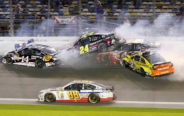 Tony Stewart (14), Jeff Gordon (24), Kurt Busch (41) and Matt Kenseth (20) crash during Saturday's NASCAR Spring Unlimited auto race at Daytona International Speedway. Dale Earnhardt Jr. (88) avoided the wreck, but Danny Hamlin won the race.