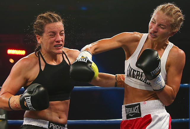 Shari Ranger and Lauryn Eagle strike each other during a Wednesday 59.5 kg catchweight Bout in Sydney, Australia. Ranger won the fight.
