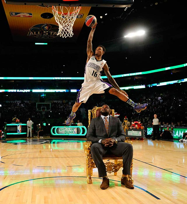 Sacramento Kings guard Ben McLemore dunks over a sitting Shaquille O'Neal during Saturday's 2014 Slam Dunk Contest.