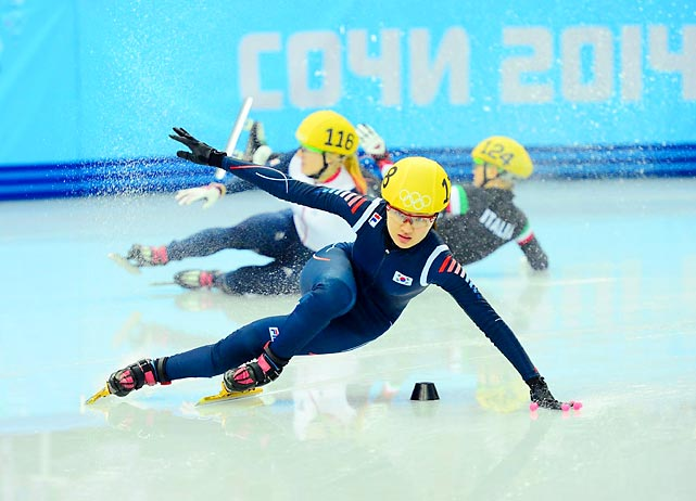 Elise Christie of Great Britain (No. 116) and Arianna Fontana of Itally (No. 124) fall to the ice during last Thursday's 500 meter short track speedskating final in Sochi while Seung-Hi Park of South Korea (No. 138) tries to maintain her balance. Park managed to win the bronze medal.
