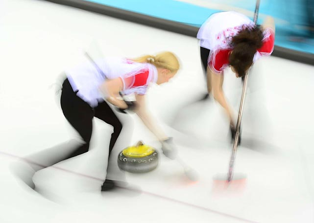 Members of the Russian curling team compete in the round robin session of the event in Sochi. The Russians eventually failed to reach the semifinals after they were eliminated in the qualifying round.
