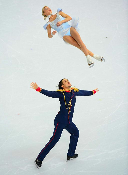Russian figure skating pair Tatiana Volosozhar and Maxim Trankov compete in the pairs short program, an event in which the duo won gold.