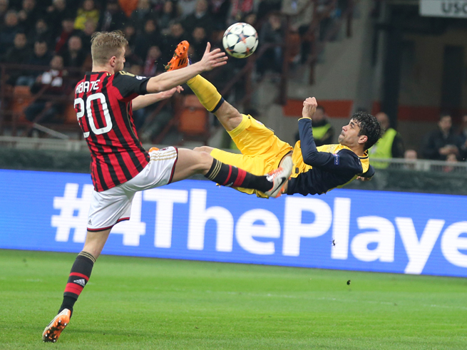 Atletico Madrid goal scorer Diego Costa goes airborne for an attempt against AC Milan in their Champions League clash on Wednesday.