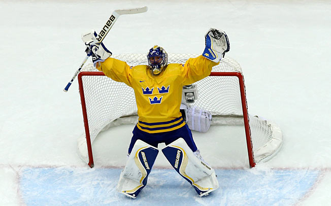 All hail the King: Henrik Lundqvist preserved a slim lead and Sweden's shot at gold.