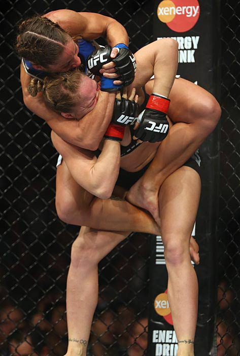 Ronda  Rousey eventually got Liz Carmouche off her back and improved her record to 7-0 with the victory.