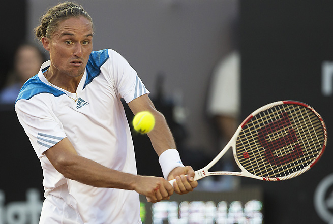 Alexandr Dolgopolov logged a rare win over David Ferrer to advance to the Rio Open final.