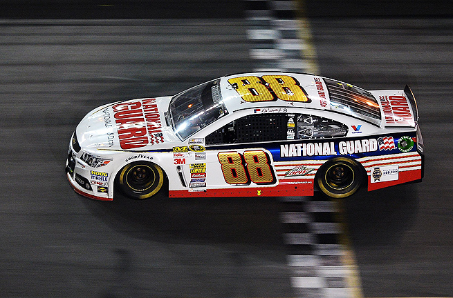 Dale Earnhardt Jr. survived a slew of late crashes to take the checkered flag at Daytona.