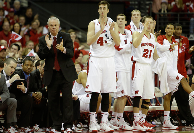 Bo Ryan (red tie, standing) coached for 15 years before getting his first Division I job.