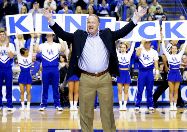 Mark Stoops hosted some class of '15 recruits at Kentucky's basketball game against Florida on Feb. 15.