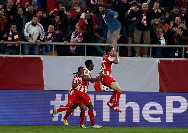 "Alejandro ""Chori"" Dominguez, right, celebrates his opening goal in Olympiakos' 2-0 victory over Manchester United in the Champions League on Tuesday."