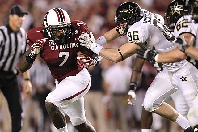 Clowney puts pressure on the Vanderbilt backfield as tight end Austin Monahan tries to hold him off.