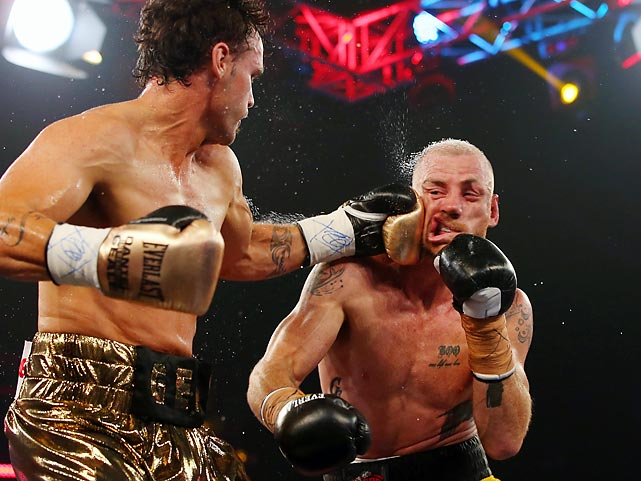 Daniel Geale of Australia lands a punch on fellow Aussie competitor Garth Wood during the IBF Middleweight Pan Pacific title bout in Sydney. Geale won.