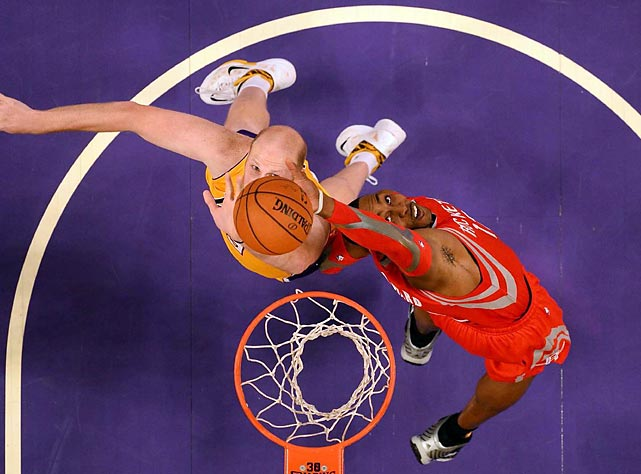 Dwight Howard of the Houston Rockets and Chris Kaman of the Los Angeles Lakers try to grab a rebound in a Wednesday game. Houston won handily, 134-108.