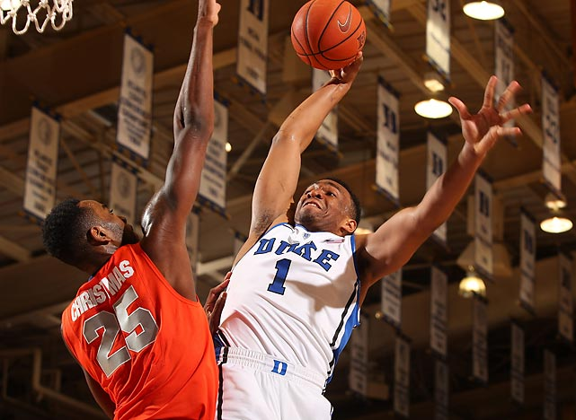 Duke's Jabari Parker barrels toward the hoop as Rakeem Christmas of Syracuse defends in a Saturday contest. Parker scored 19 points and grabbed 10 rebounds in a 66-60 victory.