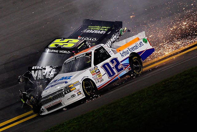 Driver Tyler Young (No. 02) and Mason Mingus crash during the Camping World Truck Series NextEra Energy Resources 250 at Daytona International Speedway, an event that preceded NASCAR's Daytona 500.