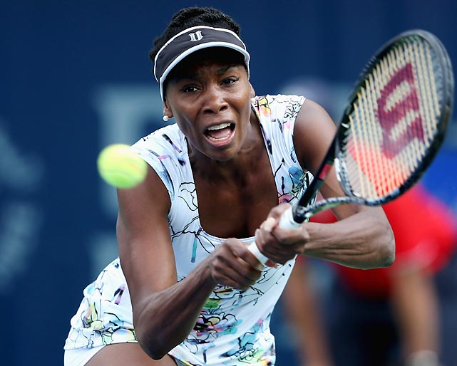 Venus Williams lunges for a backhand in a second-round match against Ana Ivanovic during the WTA Dubai Duty Free Tennis Championship. Williams won her first title since 2012.