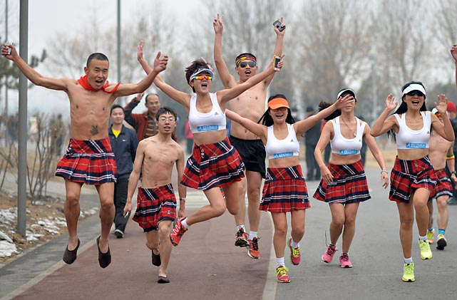 These happy participants in the annual 3.5k jaunt in China's Olympic Forest Park did not skirt the issue of the thick smog blanketing Beijing. Some of them brought along fashion accessories such as gas masks.