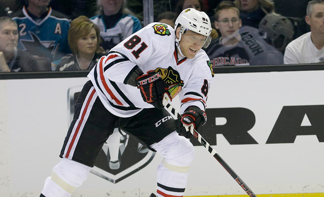 Marian Hossa left early in the first period of the Blackhawks' Stadium Series game against Pittsburgh with an upper-body injury.