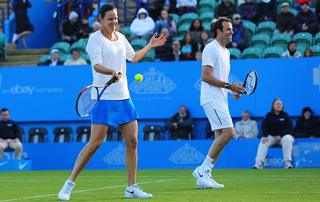 Lindsay Davenport hits alongside Greg Rusedski in a mixed doubles exhibition legends match in England last summer.