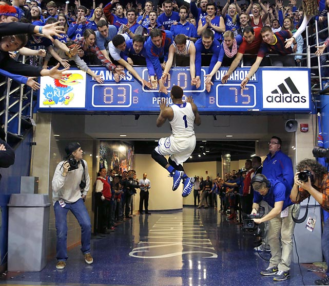 Kansas guard Wayne Selden, Jr. celebrates with fans after the Jayhawks defeated Oklahoma 83-75 in Lawrence. The win was the fourth in a row for Kansas, but the Jayhawks lost their next contest to Oklahoma State.