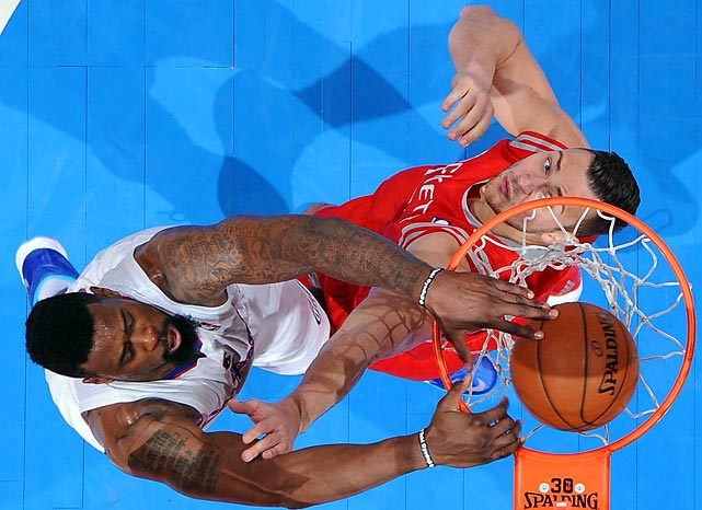 DeAndre Jordan of the Los Angeles Clippers dunks over Rockets defender during a Wednesday NBA contest at the Staples Center. The Clippers won 101-93, their third straight victory at the time.