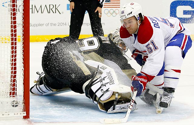 David Desharnais of the Montreal Canadiens evades Pittsburgh Penguins goaltender Marc-Andre Fleury and scores during a shootout of a Thursday NHL game. Montreal won 6-5.