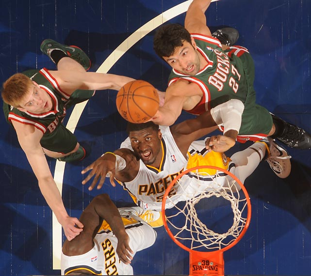Milwaukee Bucks center Zaza Pachulia attempts to lay in the basketball over Indiana's Roy Hibbert during a 101-96 loss on Thursday to the Pacers.