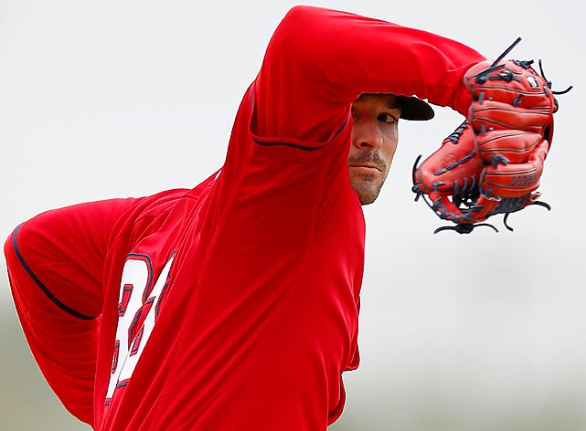 C.J. Wilson of the Los Angeles Angels winds up during spring training baseball practice on Tuesday in Arizona.
