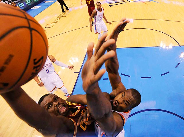 Luol Deng of the Cleveland Cavaliers drives to the hoop over Oklahoma City's Serge Ibaka during a Wednesday game. Cleveland knocked off Oklahoma City 114-104.