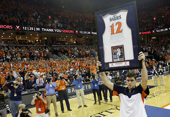 Joe Harris holds up his jersey before the Syracuse game that secured Virginia its first outright ACC title in 33 years.
