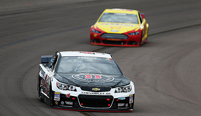 Joey Logano (rear) made a desperate attempt to catch winner Kevin Harvick at Phoenix.